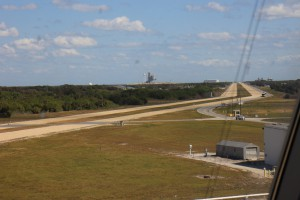View out of one of the windows to the launch pad... the white box in the distance is the SpaceX Building